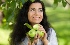 The girl with apples smiles Royalty Free Stock Photo