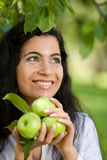 The girl with apples smiles Royalty Free Stock Photos