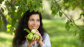 The girl with apples smiles Stock Image