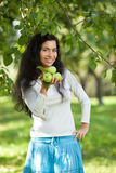 The girl with apples smiles Stock Images