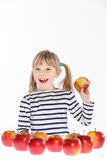 Girl with apples on a white background Stock Image