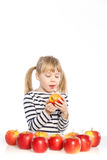 Girl with apples on a white background Stock Photos