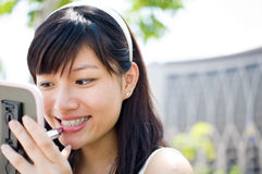 Girl apply lipstick. Close p of Asian girl apply lipstick Stock Photo