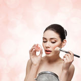 Girl applying blush Stock Photography