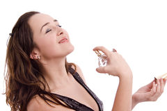 Girl applying an expensive perfume Stock Photo