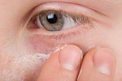 Girl applying facial cream. Teenager girl applying facial cream Royalty Free Stock Photography