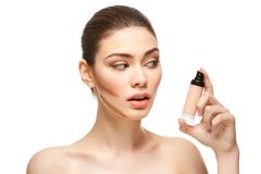 Girl applying foundation on face isolated on white Royalty Free Stock Image