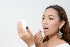 Girl Applying Lipstick Stock Photos
