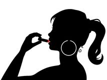 Girl Applying Lipstick Royalty Free Stock Photography