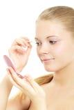 Girl Applying Make Up Stock Photography