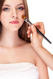 Girl applying make up on perfect skin Royalty Free Stock Photos