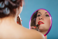 Girl applying make up red lipstick Royalty Free Stock Photos