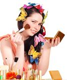 Girl applying makeup. Royalty Free Stock Photos