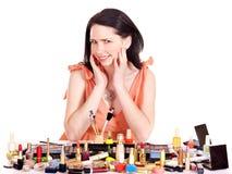 Girl applying makeup. Stock Photos