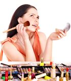 Girl applying makeup. Stock Photos