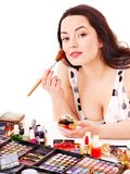 Girl applying makeup. Royalty Free Stock Image