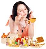 Girl applying makeup. Royalty Free Stock Photo