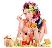 Girl applying makeup. Royalty Free Stock Photography