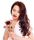 Girl applying makeup. Royalty Free Stock Images