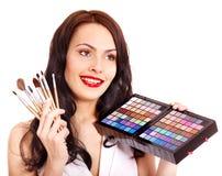 Girl applying makeup. Royalty Free Stock Photos