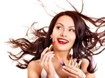 Girl applying makeup. Stock Images