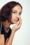 Girl applying makeup Stock Images