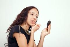 Girl applying makeup Royalty Free Stock Images