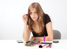 Girl applying mascara Stock Photography