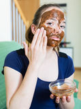 Girl applying mask for facial skin care. European girl applying mask for facial skin care Royalty Free Stock Photo