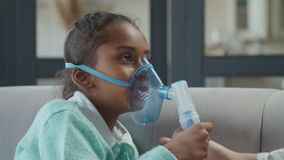 Girl applying medicine inhalation treatment indoors stock video