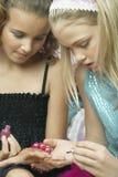 Girl Applying Nail Polish To Friend's Fingernails Stock Image