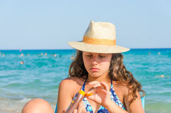 Girl applying sun block creme Stock Image