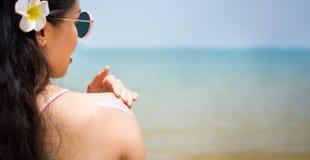 Girl applying sun lotion on summer vacation Royalty Free Stock Photo