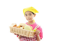 Girl in apron with bread bascket Stock Photo
