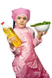 Girl apron with the dish of lettuce Stock Photos