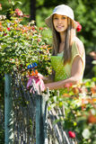 Girl in apron gardening Royalty Free Stock Photo
