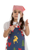 Girl in apron with spatula Royalty Free Stock Photo