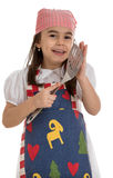 Girl in apron with spatula Royalty Free Stock Images