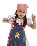 Girl in apron with spatula Stock Images