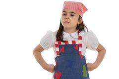 Girl in apron Royalty Free Stock Photos