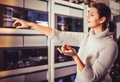 Girl in aquarium shop Stock Photo