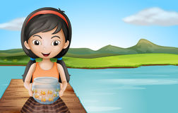 A girl with an aquarium standing at the diving board Stock Photos