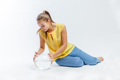 Girl with an aquarium Stock Image