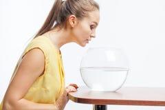 Girl with an aquarium Royalty Free Stock Photos