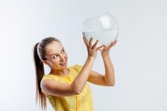 Girl with an aquarium Stock Photo
