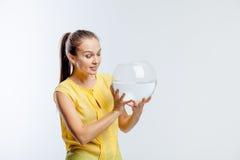 Girl with an aquarium Stock Photography