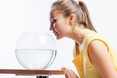 Girl with an aquarium Stock Photos