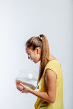 Girl with an aquarium Royalty Free Stock Photo