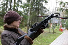 Girl with arbalest. The girl with a arbalest in park Stock Image
