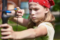 Girl archer with bow shooting Royalty Free Stock Photography